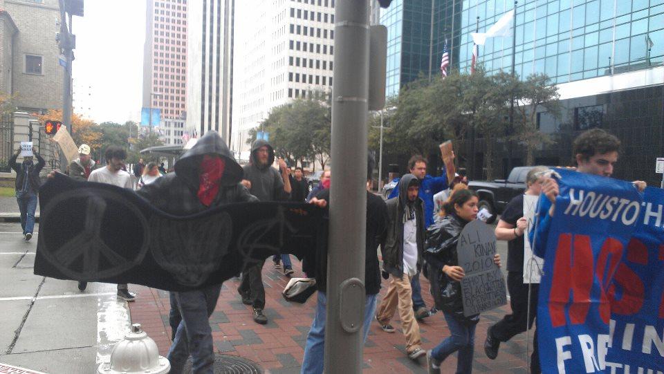 Occupy Houston protestors march to Senator Hutchison's office.  Photo Courtesy: Deyadira Trevino