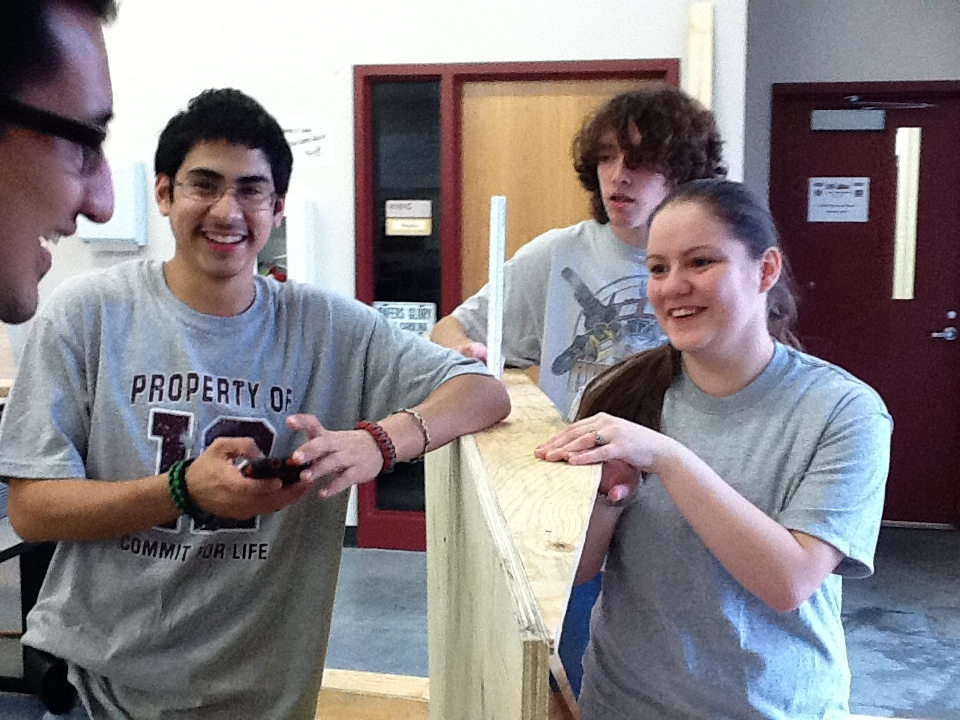 MAES students help Reagan  High with robotics kits.