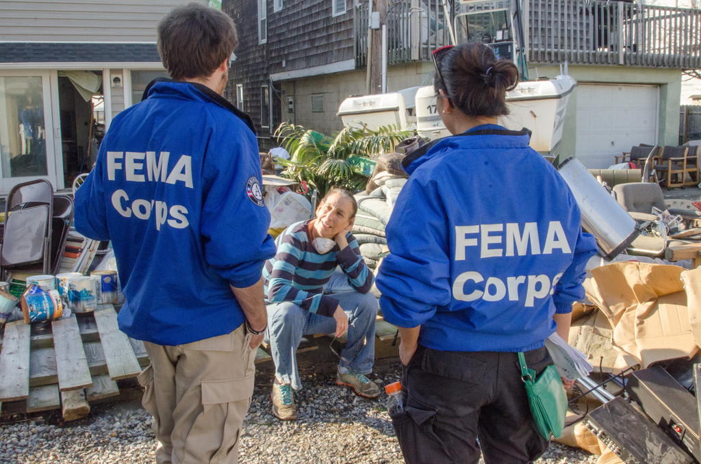 Sea Bright, NJ, 11/11/12 -- FEMA Corps team members Sergio Tundo and Gabrielle Butterfield  talked with resident Lynn Shapiro to ensure that she and her neighbors were getting the assistance from FEMA that they required after Hurricane Sandy destroyed much of the island.  Photo by Liz Roll/FEMA